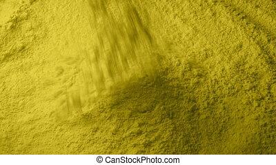 Yellow Powder Pours Into Pile - Yellow powder pours into...