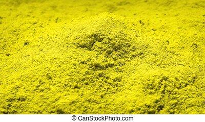 Yellow Powder Rotating - Pile of yellow powder turning...
