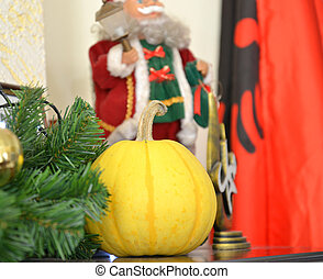 yellow pumpkin with santa claus decoration on the back