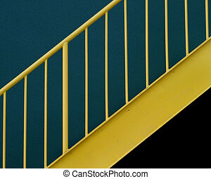 Yellow Railing - A yellow railing against a green wall.