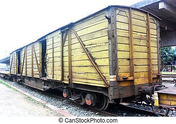 Yellow railway freight wooden wagon