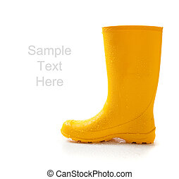 Yellow rainboots on white with copy space