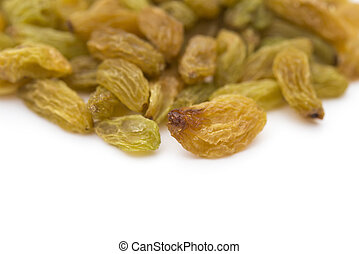 yellow raisins on a white background with copy space
