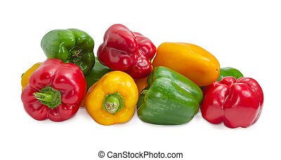 Yellow, red and green bell peppers on a light background