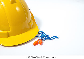 Yellow reusable ear plugs in construction site, personal safety equipment concept.