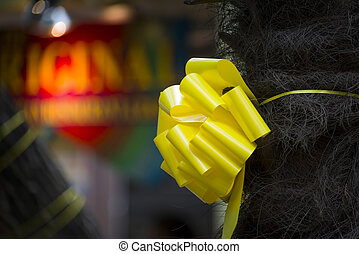 Yellow Ribbon Honoring Our Troops - Yellow ribbon tied...