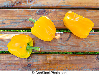 Yellow ripe freshly picked peppers