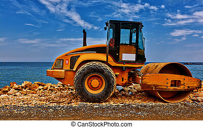 Yellow road building machinery. - Yellow road building ...