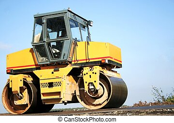 Yellow road-roller on the roadway