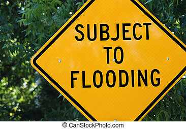 Yellow warning sign which reads: 'Subject to Flooding'