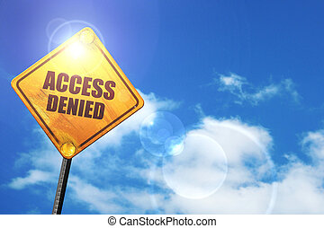 Yellow road sign with a blue sky and white clouds: access denied