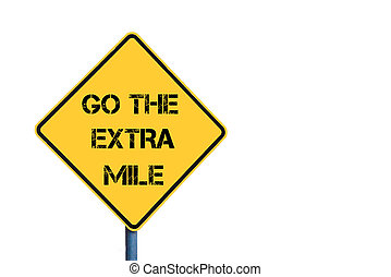 Yellow roadsign with Go The Extra Mile message