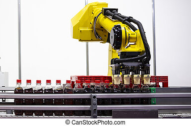 Yellow robotic arm soda bottles
