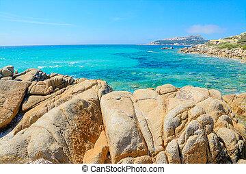 yellow rocks by Santa Reparata beach