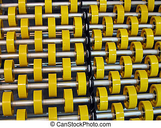 yellow roller heap on metal tubes, industry details