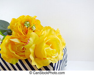 yellow rose artificial flower in the box with space copy background