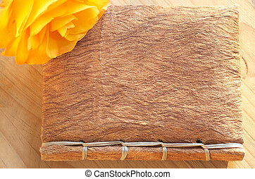 Yellow rose on a book