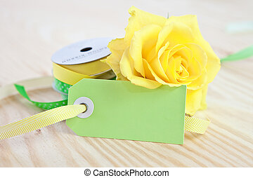 Yellow rose with a blank tag