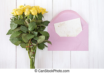 Yellow roses and love letter