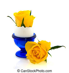 Yellow roses - Yellow rose in blue egg cup over white