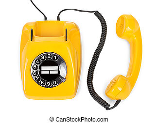 yellow rotary phone on white background