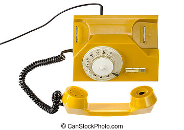 Yellow rotary phone isolated on white background. Top view.