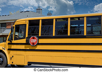 Yellow school bus for children educational transport on the street