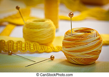 Yellow sewing thread and ribbons, landscape - Yellow sewing...