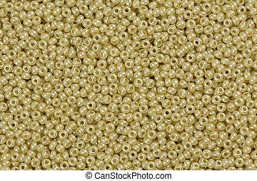 Yellow shining beads texture.