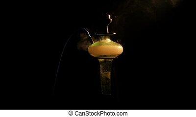 yellow shisha on lounge caffee. slow motion - Colored yellow...