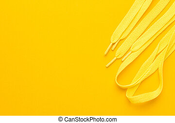 yellow shoe laces - sport shoe laces on the yellow...