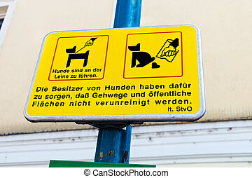 yellow sign, dogs in the city