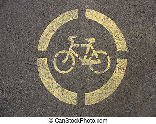 Yellow sign of a bicycle on the asphalt