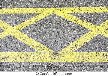 Yellow sign on asphalt