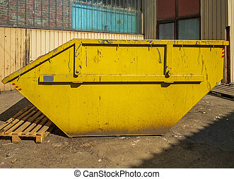 Yellow Skip Container in Front of Building