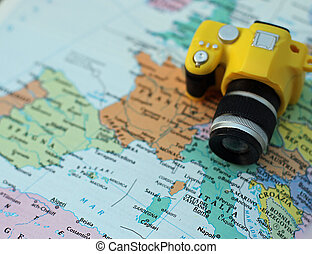small toy camera on the map of Europe and Italy