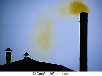 Yellow smoke from Silhouette of factory pipe over dark blue sky