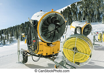 Yellow snow blower machines used for preparing the skiing in...