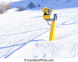 snow cannon on the ski slopes. Artificial snow making  machine