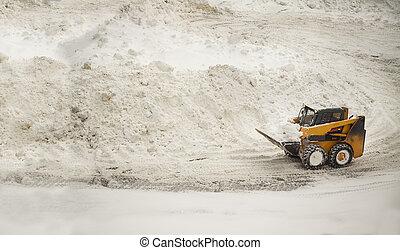 Yellow snow removing bulldozer