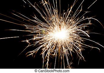 spark - yellow sparkler holiday background on black
