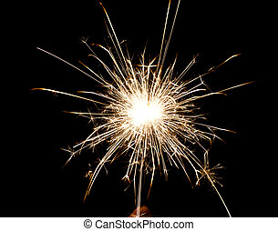 spark - yellow sparkler holiday background on black