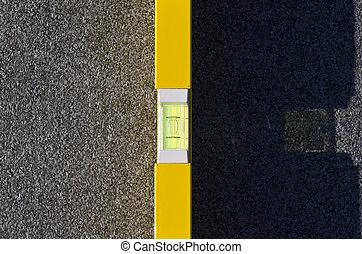 spirit level - Yellow spirit level on a roof
