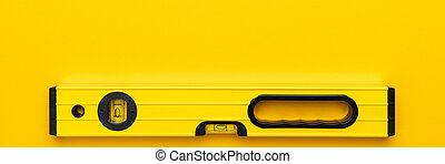 Yellow spirit level on the yellow background. Panoramic ...