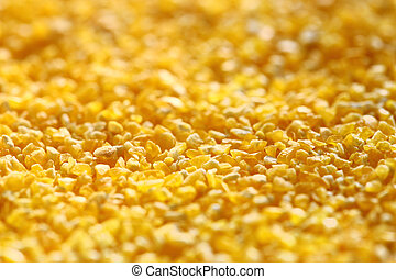 Yellow splintered corn as background