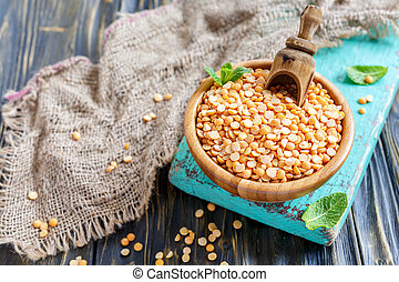 Yellow split peas in a wooden bowl.
