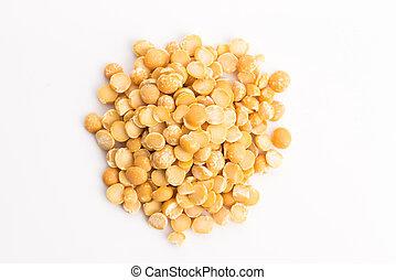 Yellow split peas isolated on white background