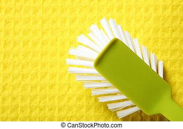 Yellow sponge background and brush