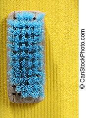 yellow sponge background and old brush