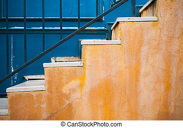 Colorful yellow stair and contrast blue wall